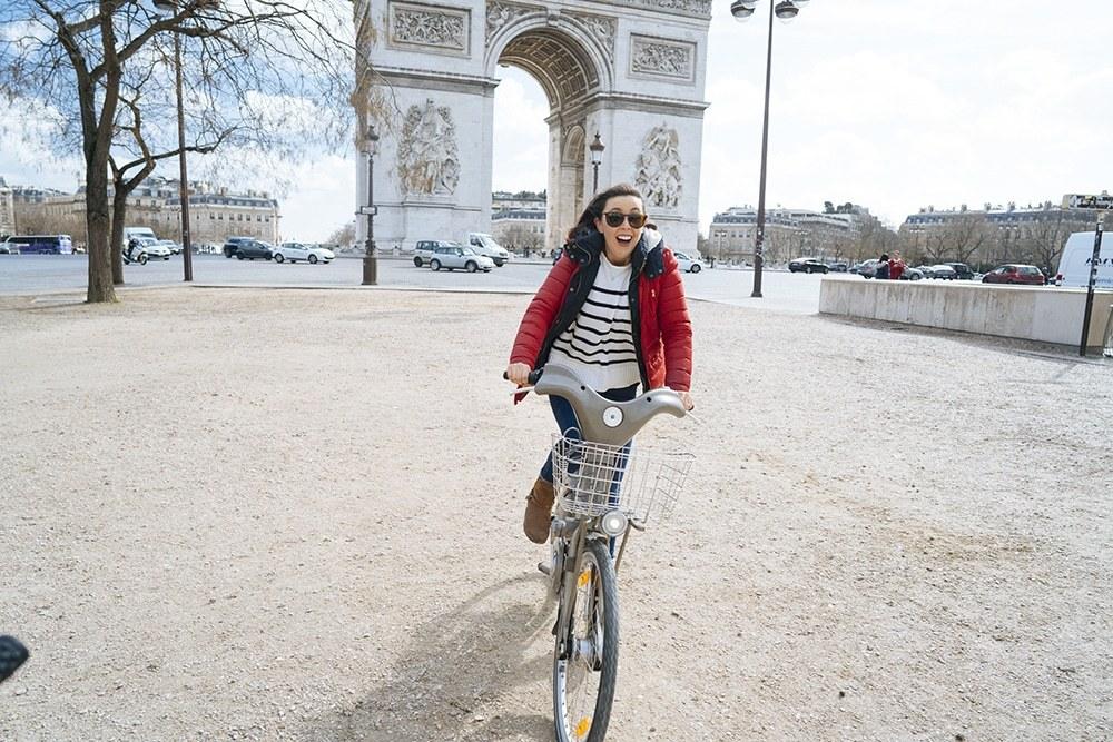 Paris with Kids Riding Bikes near the Arc de Triomphe