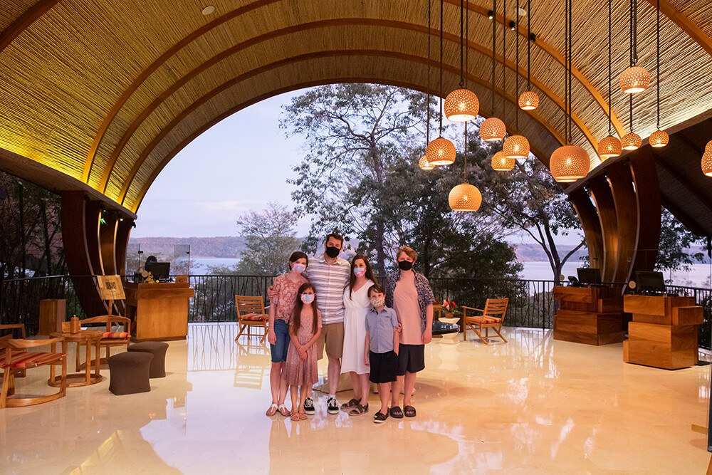 Andaz Costa Rica Resort at Peninsula Papagayo: A Review for Families Family in the lobby with masks on